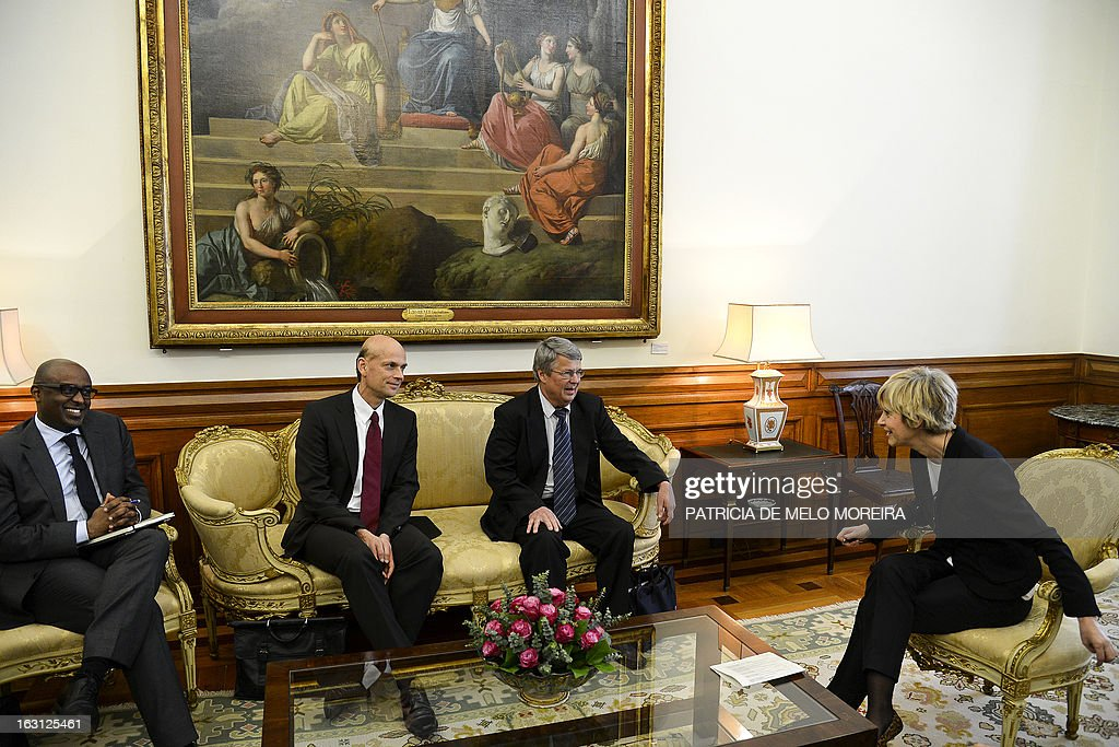 Abebe Selassie, International Monetary Fund (IMF) mission chief for Portugal, Rasmus Ruffer, head of the European Central Bank (ECB) delegationto Portugal, Jurgen Kroger, head of European Union (EU) delegationn (EU) attend a meeting with the President of the Portuguese Parliament Assuncao Esteves (R) in Lisbon on March 05, 2013. AFP PHOTO / PATRICIA DE MELO MOREIRA