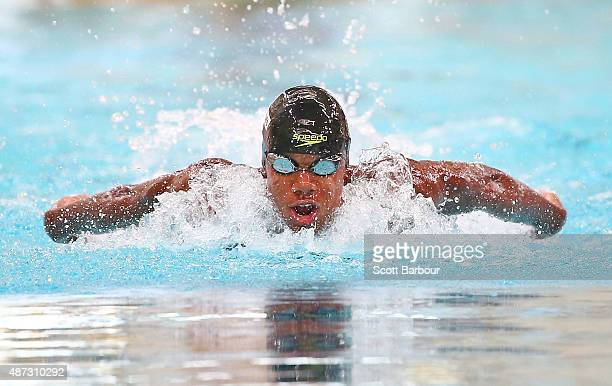 Abeiku Gyekye Jackson of Ghana competes in the Men's 100m Butterfly preliminaries at the Aquatic Centre of the Tuanaimato Sports Facility on day...