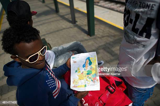 Abel a 19yearold from Ethiopia shows a map of europe while sitting in an abandoned train station after being asked to leave the train he could not...