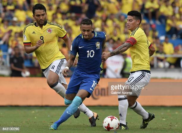 Abel Aguilar and James Rodriguez of Colombia struggle for the ball with Neymar Jr of Brazil during a match between Colombia and Brazil as part of...