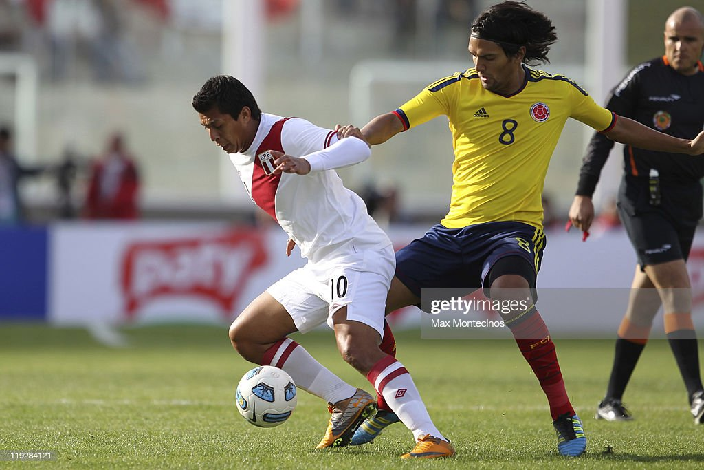 <a gi-track='captionPersonalityLinkClicked' href=/galleries/search?phrase=Abel+Aguilar&family=editorial&specificpeople=2309935 ng-click='$event.stopPropagation()'>Abel Aguilar</a>, from Colombia, (L) fights for the ball with Rinaldo Cruzado, from Peru, During a quarter final match between Colombia and Peru at Mario Alberto Kempes Stadium on July 16, 2011 in Cordoba, Argentina.