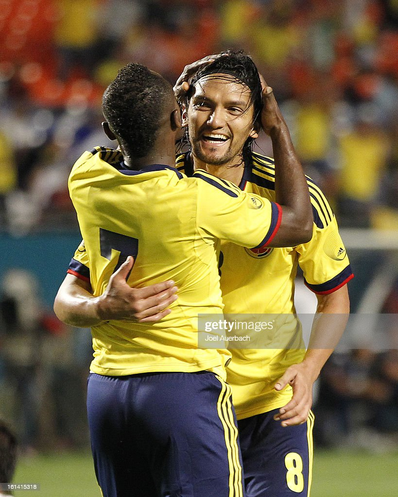 <a gi-track='captionPersonalityLinkClicked' href=/galleries/search?phrase=Abel+Aguilar&family=editorial&specificpeople=2309935 ng-click='$event.stopPropagation()'>Abel Aguilar</a> #8 is congratulated by Pablo Armero #7 of Colombia after he scored a goal against Guatemala during second half action on February 6, 2013 at SunLife Stadium in Miami Gardens, Florida. Colombia defeated Guatemala 4-1.