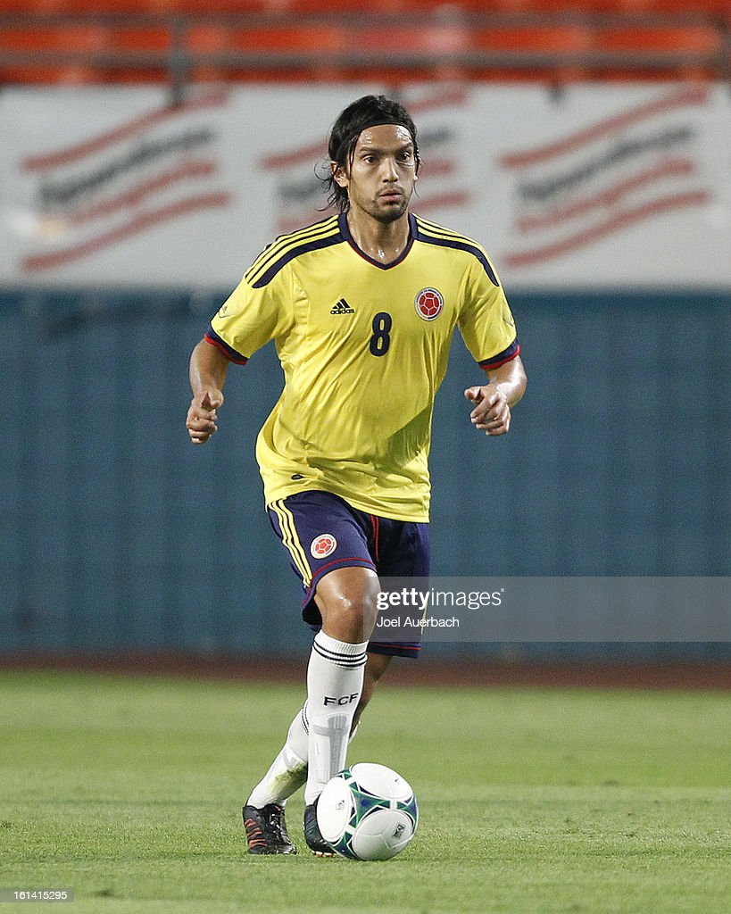 <a gi-track='captionPersonalityLinkClicked' href=/galleries/search?phrase=Abel+Aguilar&family=editorial&specificpeople=2309935 ng-click='$event.stopPropagation()'>Abel Aguilar</a> #8 of Colombia brings the ball up field against Guatemala on February 6, 2013 at SunLife Stadium in Miami Gardens, Florida. Colombia defeated Guatemala 4-1.