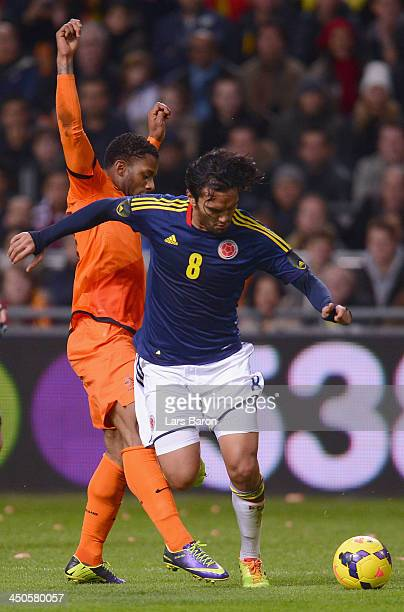 Abel Aguilar of Colombia is challenged by Jeremain Lens of Netherlands during the International Friendly match between Netherlands and Colombia at...