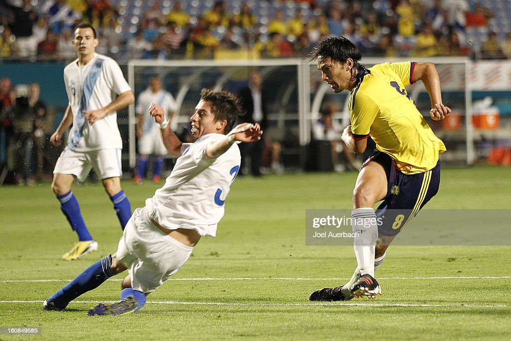 <a gi-track='captionPersonalityLinkClicked' href=/galleries/search?phrase=Abel+Aguilar&family=editorial&specificpeople=2309935 ng-click='$event.stopPropagation()'>Abel Aguilar</a> #8 of Colombia scores past Elias Vasquez #3 of Guatemala on February 6, 2013 at SunLife Stadium Stadium in Miami Gardens, Florida. Colombia defeated Guatemala 4-1.