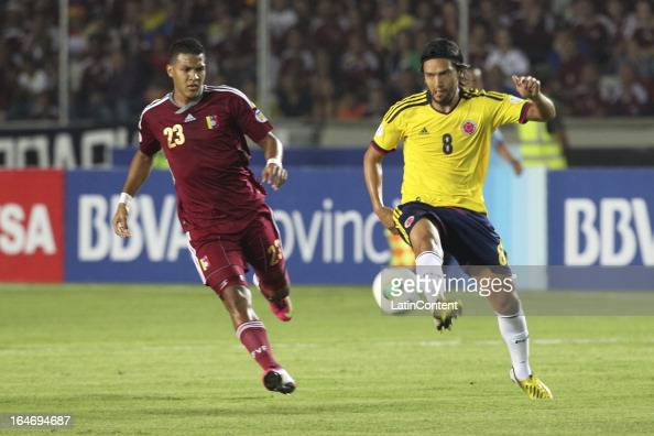 Abel Aguilar of Colombia struggles for the ball with Jose Rondon during a match between Venezuela and Colombia as part of the 12th round of the South...