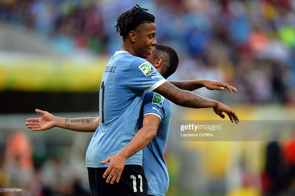 Abel Hernandez and <a gi-track='captionPersonalityLinkClicked' href=/galleries/search?phrase=Diego+Perez&family=editorial&specificpeople=697338 ng-click='$event.stopPropagation()'>Diego Perez</a> of Uruguay celebrate after a goal during the FIFA Confederations Cup Brazil 2013 Group B match between Uruguay and Tahiti at Arena Pernambuco on June 22, 2013 in Recife, Brazil.