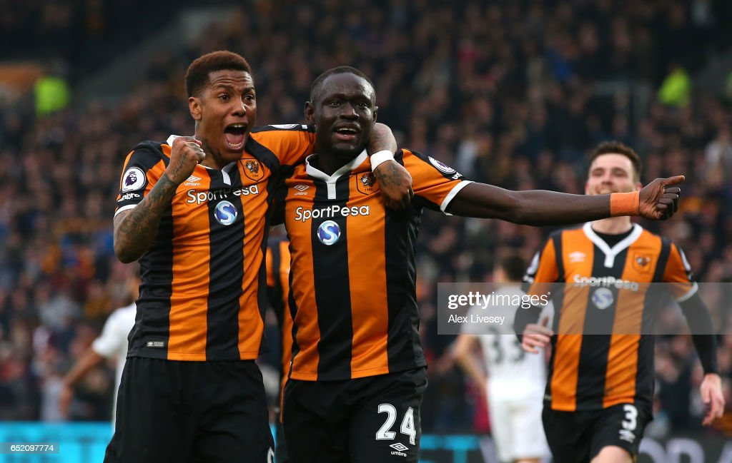 Abel Hernandez of Hull City (L) celebrates scoring his sides first goal with Oumar Niasse of Hull City (R) during the Premier League match between Hull City and Swansea City at KCOM Stadium on March 11, 2017 in Hull, England.