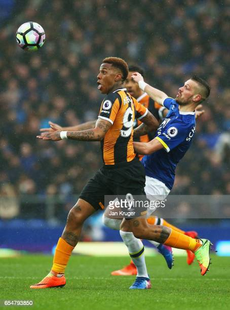 Abel Hernandez of Hull City holds off Morgan Schneiderlin of Everton during the Premier League match between Everton and Hull City at Goodison Park...