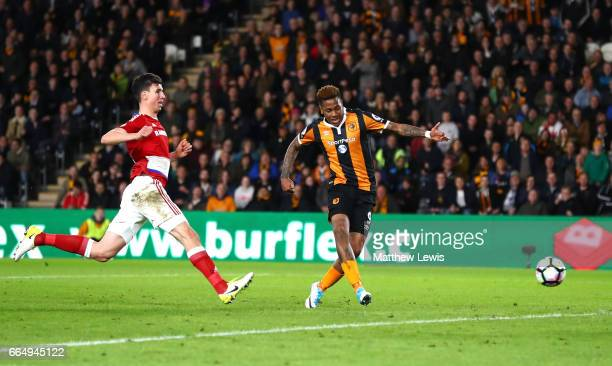 Abel Hernandez of Hull City scores his sides third goal during the Premier League match between Hull City and Middlesbrough at the KCOM Stadium on...