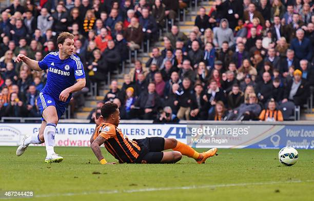 Abel Hernandez of Hull City scores their second goal as Branislav Ivanovic of Chelsea looks on during the Barclays Premier League match between Hull...