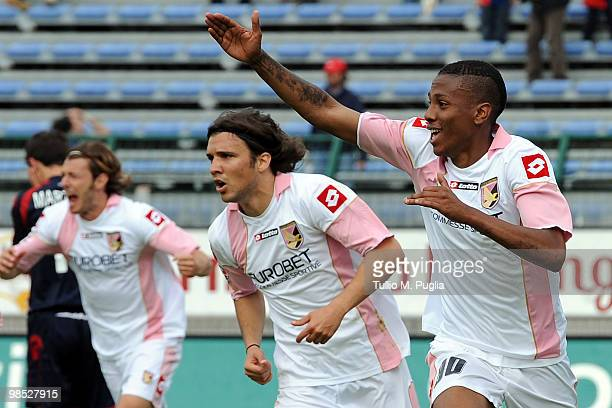 Abel Hernandez of Palermo and his teammates Federico Balzaretti and Nicolas Bertolo celebrate the equalizing goal during the Serie A match between...