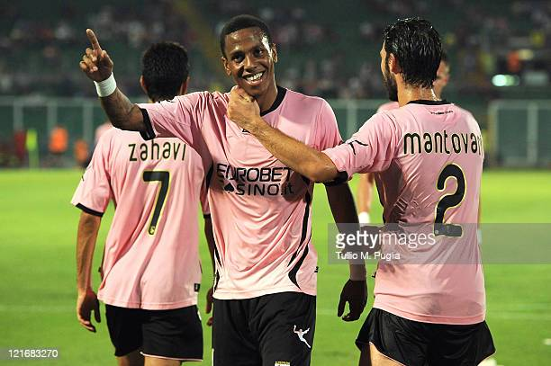 Abel Hernandez of Palermo celebrates with Eran Zahavi and Andrea Mantovani after scoring a penalty during the pre season friendly match between Us...