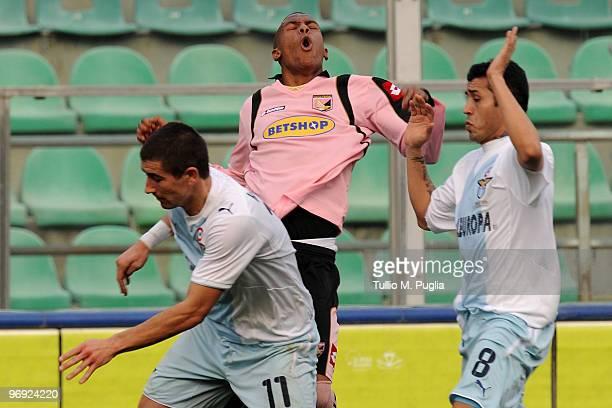 Abel Hernandez of Palermo is challenged by Aleksandar Kolarov and Francelino Da Silva Matuzalem of Lazio during the Serie A match between US Citta di...
