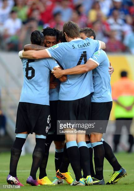Abel Hernandez of Uruguay celebrates with his team after scoring a goal in the 2nd minute against Tahiti during the FIFA Confederations Cup Brazil...