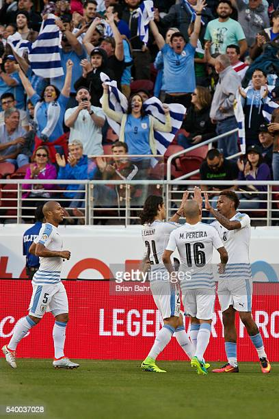 Abel Hernandez of Uruguay celebrates with teammates after scoring the opening goal during a group C match between Uruguay and Jamaica at Levi's...
