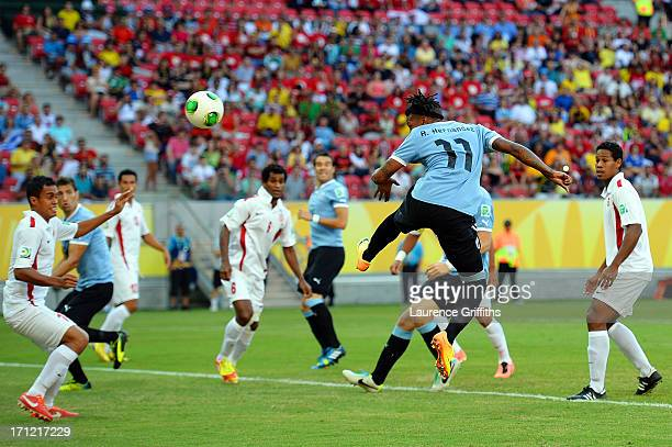 Abel Hernandez of Uruguay hits a header to score a goal in the 2nd minute against Tahiti during the FIFA Confederations Cup Brazil 2013 Group B match...