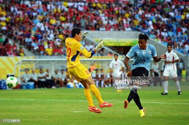 Abel Hernandez of Uruguay scores a goal in the 24th minute against Gilbert Meriel of Tahiti during the FIFA Confederations Cup Brazil 2013 Group B...