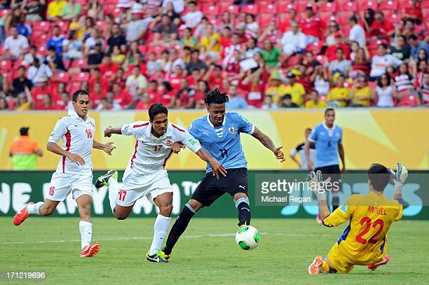Abel Hernandez of Uruguay scores his third goal of the match against Jonathan Tehau and Gilbert Meriel of Tahiti during the FIFA Confederations Cup...