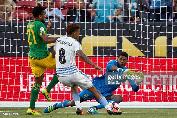 Abel Hernandez of Uruguay shoots to score the opening goal past Andre Blake of Jamaica during a group C match between Uruguay and Jamaica at Levi's...