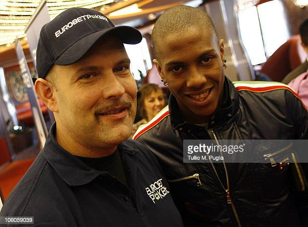 Abel Hernandez poses with a fan on the ship for the opening tournaments of the Mediterranean Cruise Eurobetpoker on October 26 2010 in Palermo Italy...