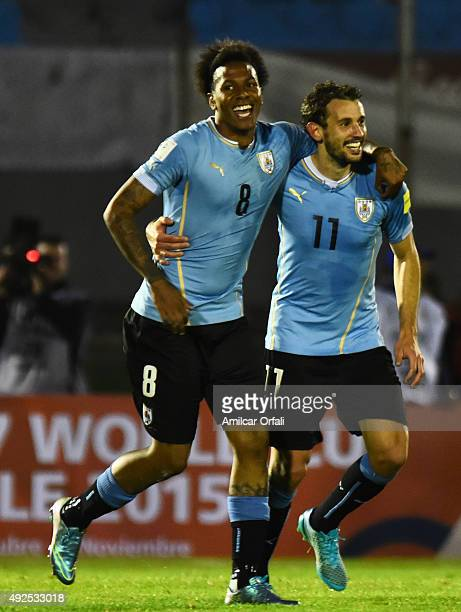 Abel Hernández of Uruguay celebrates with Cristhian Stuani after scoring the thrid goal during a match between Uruguay and Colombia as part of FIFA...