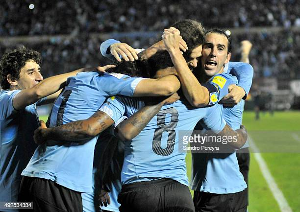 Abel Hernández of Uruguay celebrates with teammates after scoring the third goal during a match between Uruguay and Colombia as part of FIFA 2018...