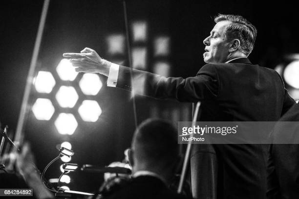 Abel Korzeniowski conductes an orchestra during 'The Music of Abel Korzeniowski' concert in ICE Congress Centre at 10 edition of the annual Film...