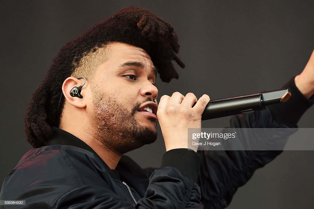 Abel Makkonen Tesfaye a.k.a <a gi-track='captionPersonalityLinkClicked' href=/galleries/search?phrase=The+Weeknd+-+Musician&family=editorial&specificpeople=8008743 ng-click='$event.stopPropagation()'>The Weeknd</a> performs during day 2 of BBC Radio 1's Big Weekend at Powderham Castle on May 29, 2016 in Exeter, England.