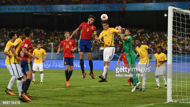 Abel Ruiz of Spain and Lucas Halter of Brazil challenge for the ball during the FIFA U17 World Cup India 2017 group D match between Brazil and Spain...