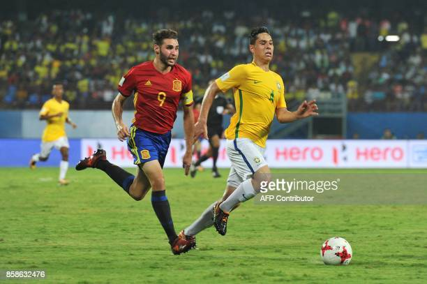 Abel Ruiz of Spain and Lucas Halter of Brazil compete for the ball during their group stage football match of the FIFA U17 World Cup at the...