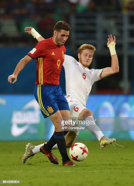 Abel Ruiz of Spain and Taha Shariati of Iran compete for the ball during their quarterfinal football match of the FIFA U17 World Cup at the...