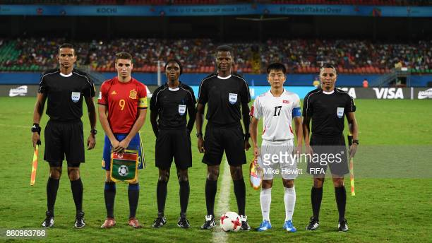 Abel Ruiz of Spain and Yun Min of Korea DPR pose for a photo with the match officials ahead of the FIFA U17 World Cup India 2017 group D match...