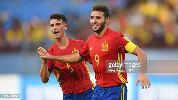 Abel Ruiz of Spain celebrates with team mate Antonio Blanco after scoring his second goal during the FIFA U17 World Cup India 2017 group D match...