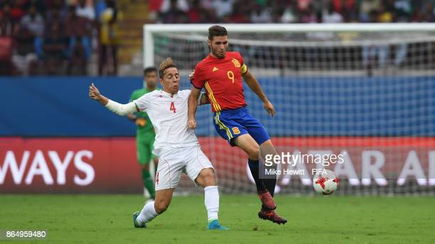 Abel Ruiz of Spain is challenged by Amir Esmaeil Zadeh of Iran during the FIFA U17 World Cup India 2017 Quarter Final match between Spain and Iran at...