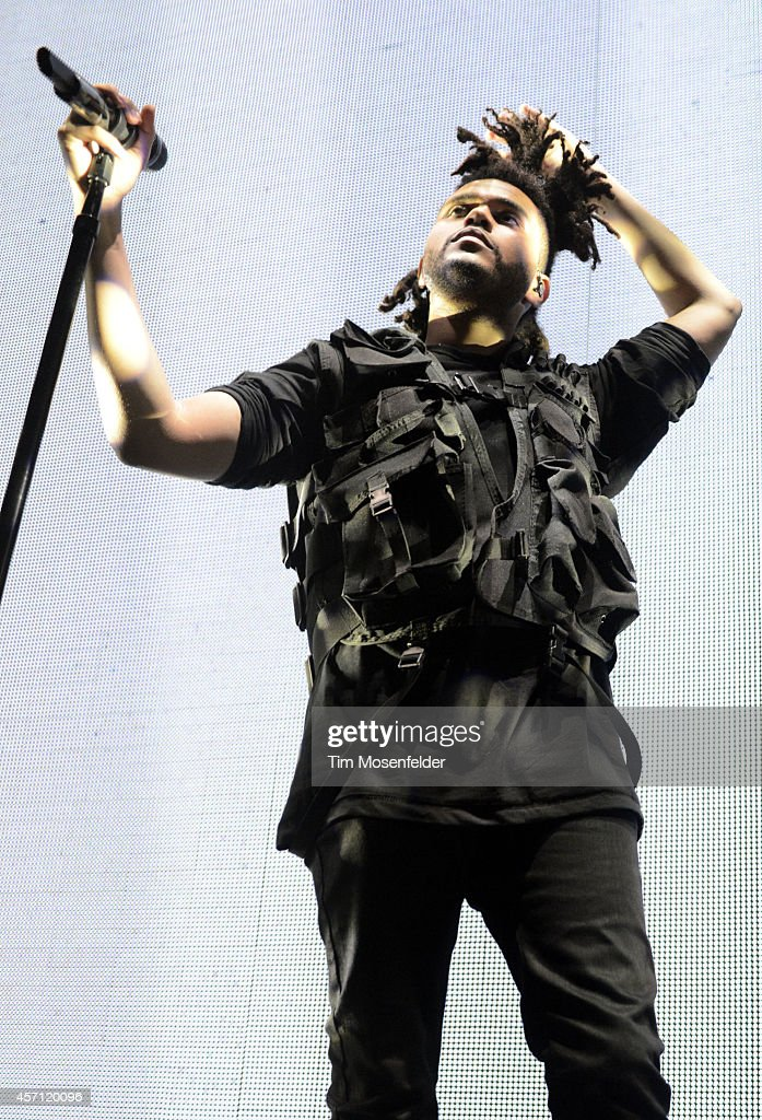 Abel Tesfaye aka <a gi-track='captionPersonalityLinkClicked' href=/galleries/search?phrase=The+Weeknd+-+Musician&family=editorial&specificpeople=8008743 ng-click='$event.stopPropagation()'>The Weeknd</a> performs at the Bill Graham Civic Auditorium on October 11, 2014 in San Francisco, California.