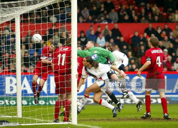 Aberdeen defender Kevin McNaughton puts the ball into his own net'