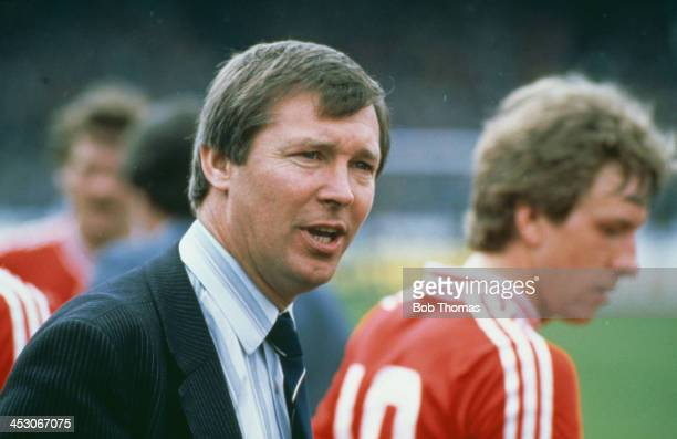 Aberdeen FC manager Alex Ferguson talks to his players in the interval before extra time in the Scottish Cup final against Rangers FC at Hampden Park...