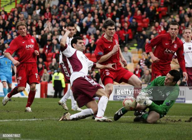 Aberdeen goalkeeper Jamie Langfield stops a shot from Hearts' Christos Karipidis during the Bank of Scotland Premier League match at Pittodrie...