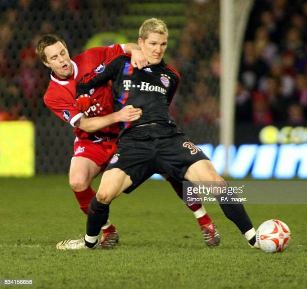 Aberdeen's Alan Maybury and Bayern Munich's Bastian Schweinsteiger during the UEFA Cup match at the Pittodrie Stadium Aberdeen