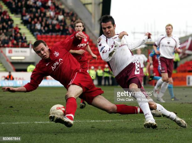 Aberdeen's Andrew Considine clears the ball from the path of Hearts' Michal Pospisil during the Bank of Scotland Premier League match at Pittodrie...