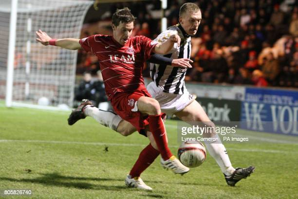 Aberdeen's Christopher Maguire and St Mirren's Michael Paton in action