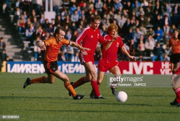 Aberdeen's Gordon Strachan surges past teammate Steve Cowan and Dundee United's Eamon Bannon