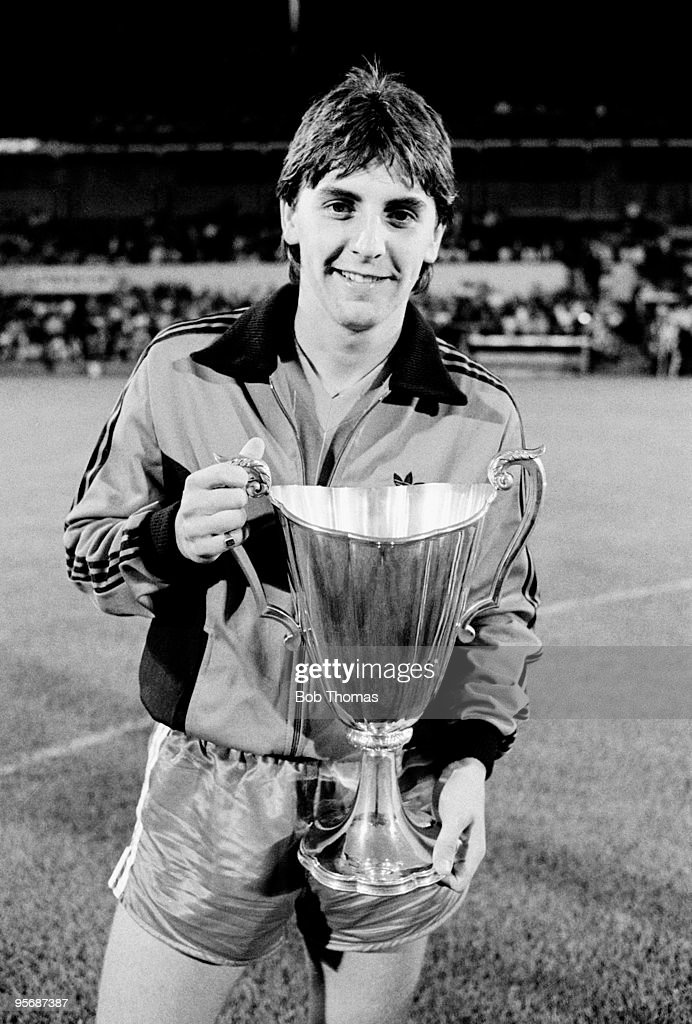 Aberdeen's John Hewitt holds the European Cup Winners Cup trophy, which his goal helped to win, prior to the George Burley Testimonial match between Ipswich Town and Aberdeen held at Portman Road, Ipswich in August 1983. Ipswich Town won 3-0. (Bob Thomas/Getty Images).