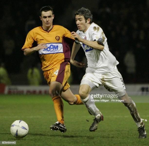 Aberdeens Kevin McNaughton challenges Motherwells Brian Kerr