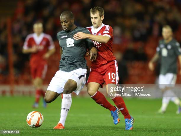 Aberdeen's Niall McGinn tackles Partick Thistles Isaac Osbourne during the Scottish Premiership match at Pittodrie Stadium Aberdeen