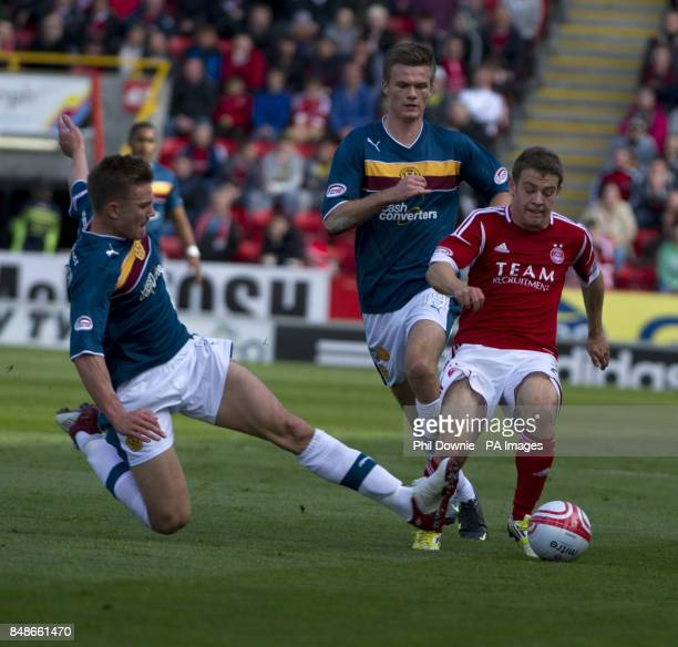 Aberdeen's Ryan Fraser passes Motherwell's Steven Hammell during the Clydesdale Bank Scottish Premier League match at the Pittodrie Stadium Aberdeen