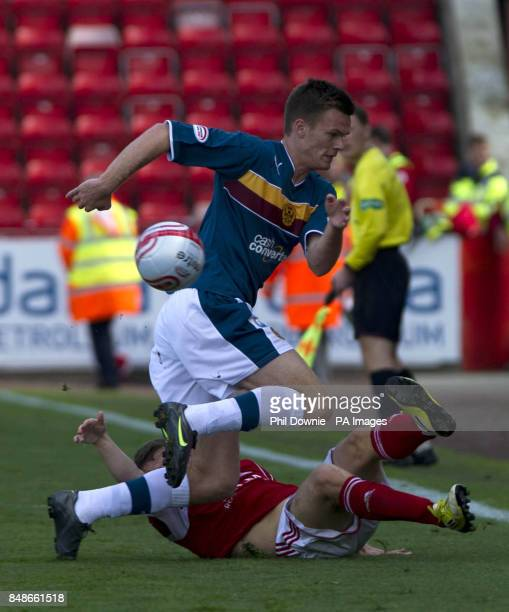 Aberdeen's Ryan Fraser succumbs to Motherwell's Michael Higdon during the Clydesdale Bank Scottish Premier League match at the Pittodrie Stadium...