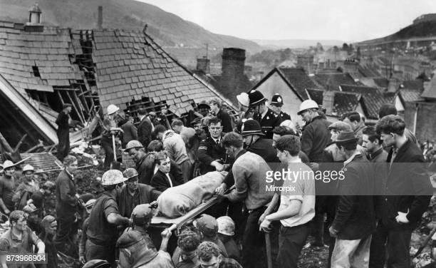 Aberfan 21st October 1966 For a moment the digging stops as another body is brought from the shattered Pantglas Junior School following the...