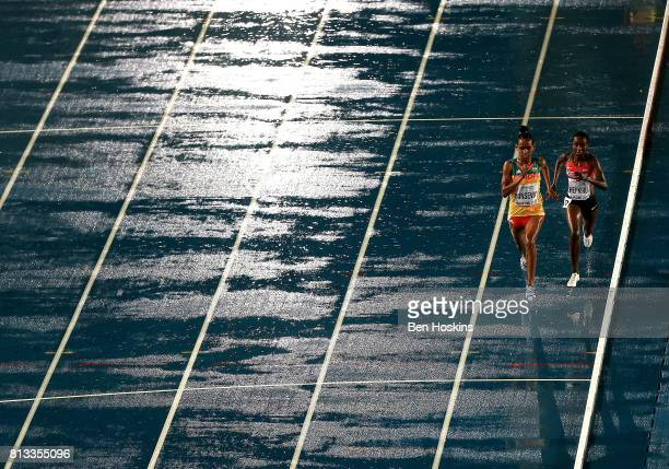 Abersh Minsewo of Ethiopia and Emmaculate Chepkirui of Kenya race down the home straight during the final of the womens 3000m on day one of the IAAF...